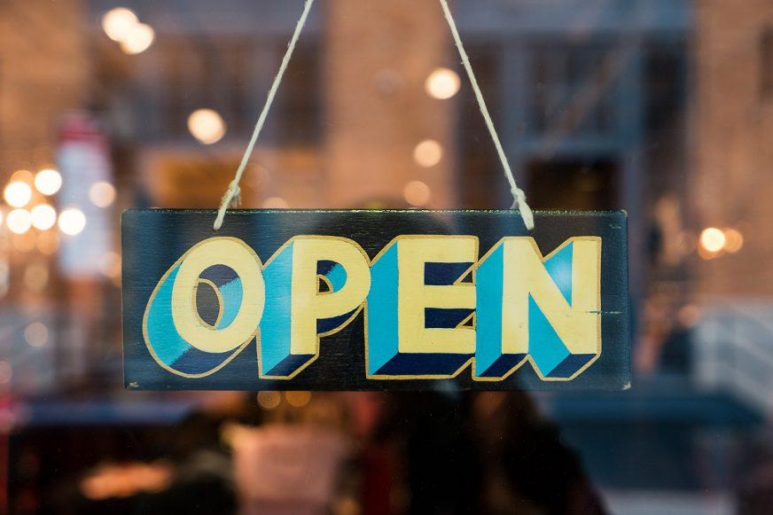 A shop door with an Open sign
