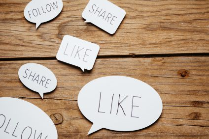Cut-out speech bubbles with social media terms
