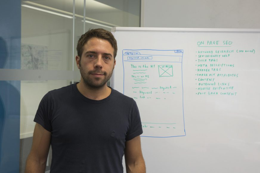 man standing in front of a whiteboard