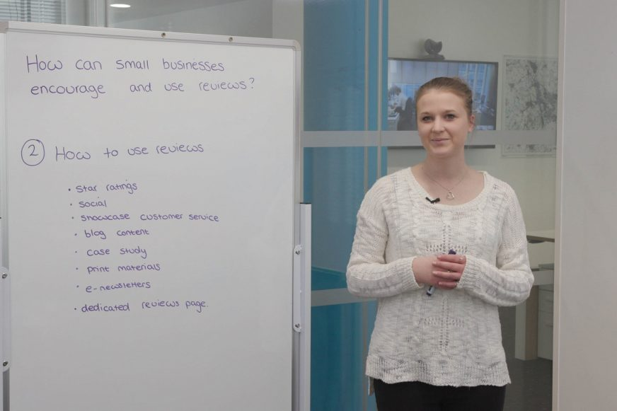 Woman stood in front of a whiteboard