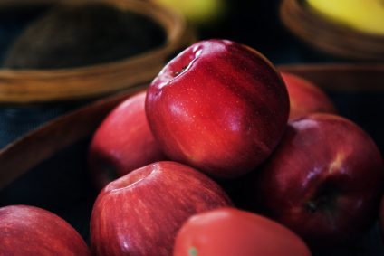 apples stacked in a bowl