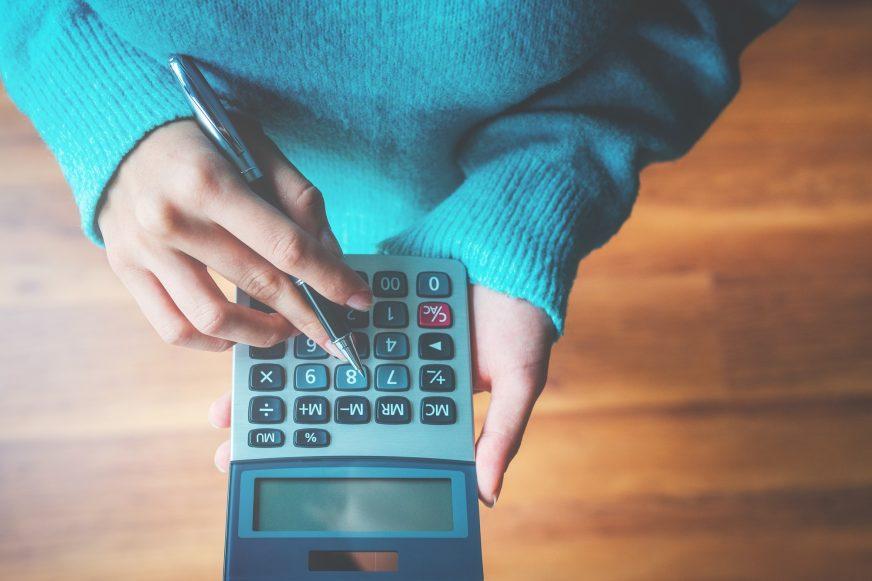 person holding calculator
