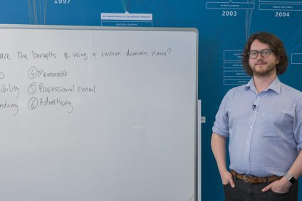 Man stood in front of a whiteboard