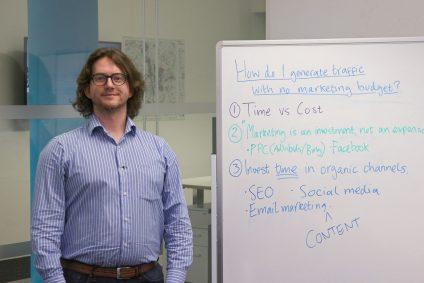 Marketing expert by whiteboard