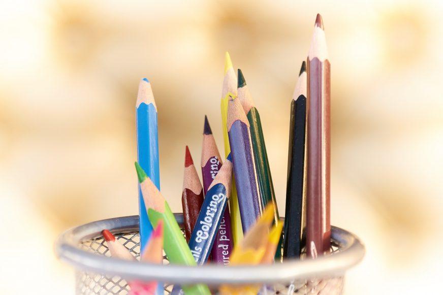 Pot full of coloured pencils