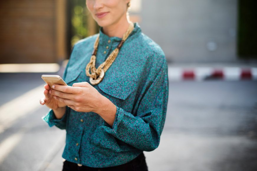 woman using her mobile phone