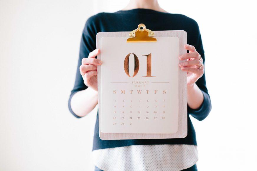 Woman holding a calendar on a clipboard