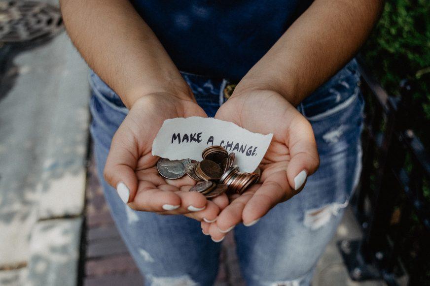 hands holding loose change