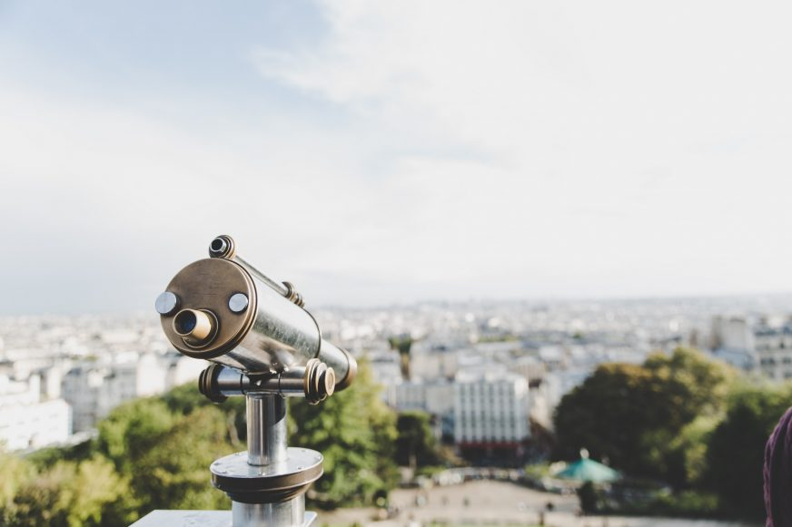 telescope looking over city