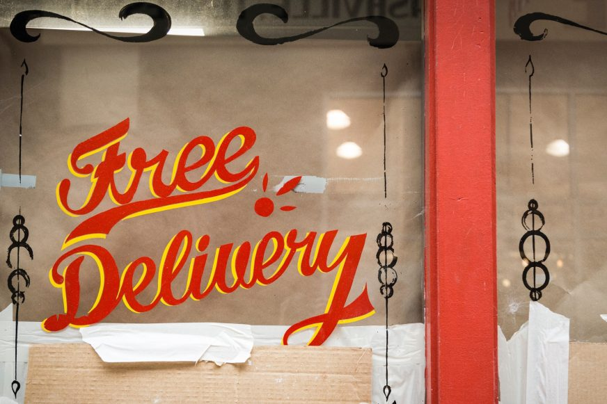 free delivery sign painted on window