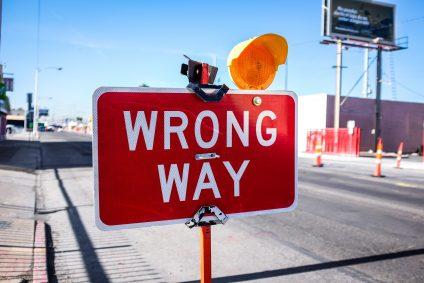 Red wrong way road sign warning