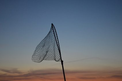 fishing net against dusk sky