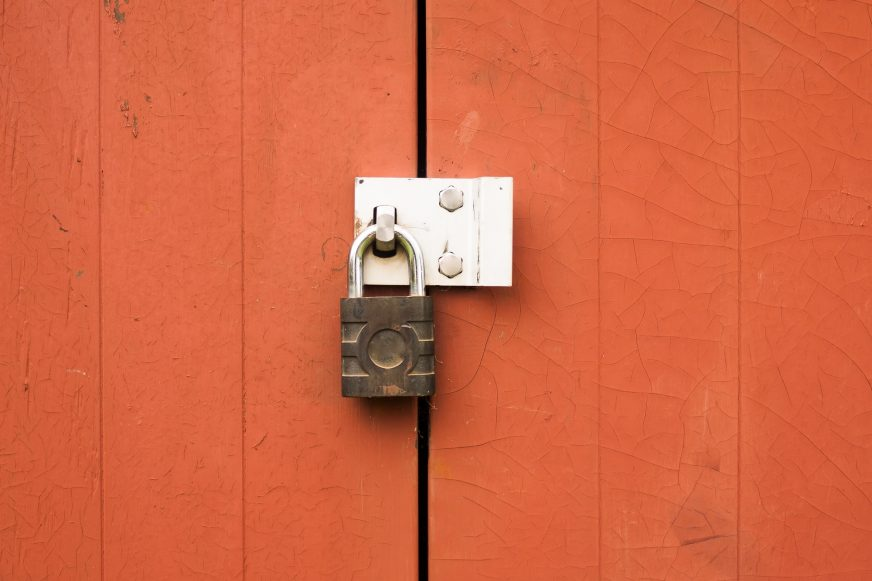 padlock on orange doors