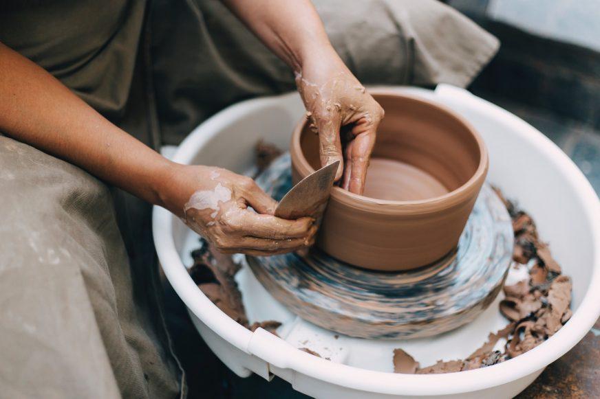 Potter sat at a potters wheel