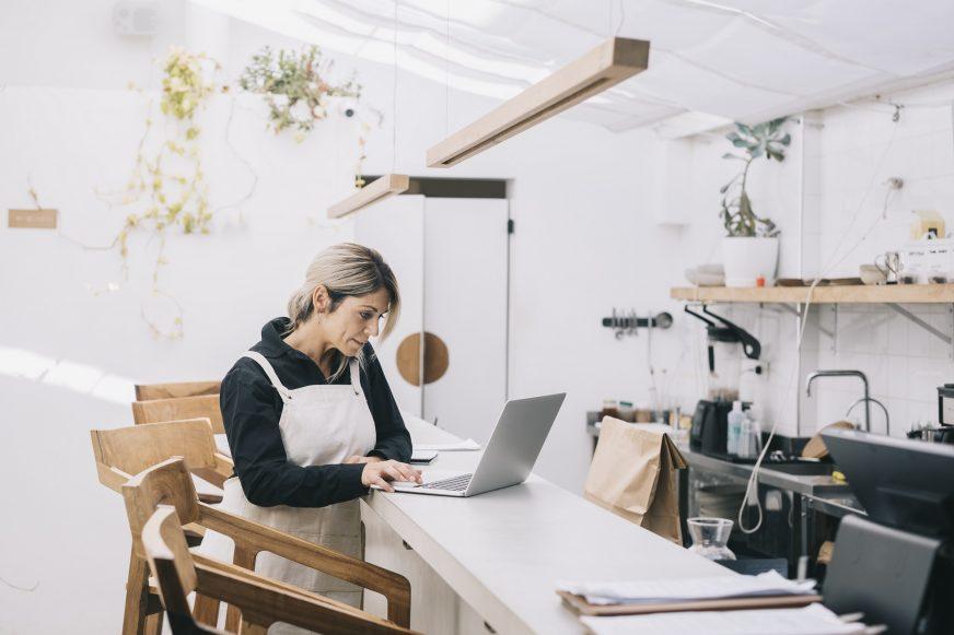 cafe owner on laptop